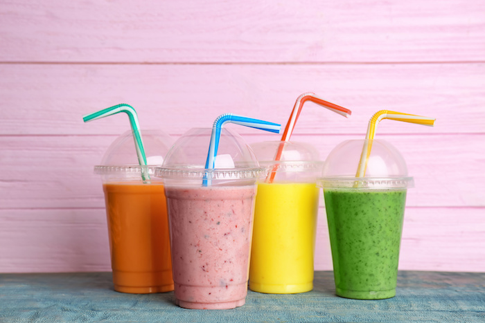"6 ""Healthy Foods"" That May Be Sabotaging Your Weight Loss Goals; Plastic cups with delicious detox smoothies on table"