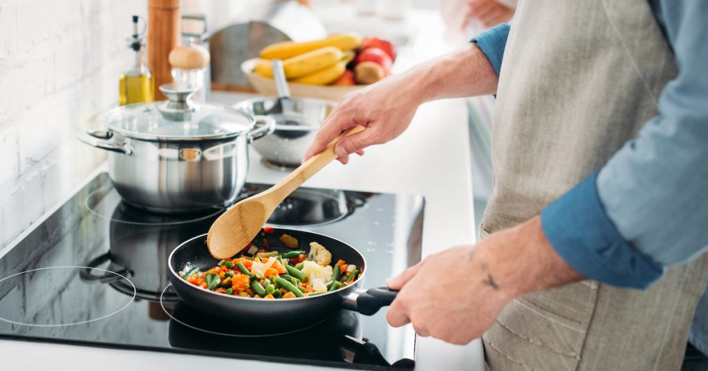 cropped image of boyfriend frying vegetables on frying pan in kitchen; 4 Heart-Healthy Recipes Good for Weight Loss