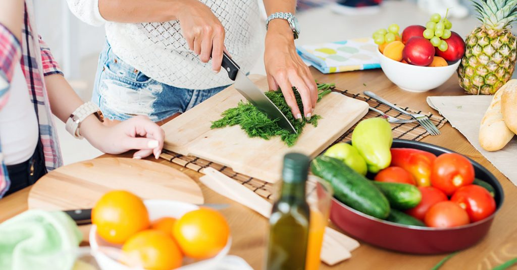 Gorgeous young Women preparing dinner in a kitchen concept cooking, culinary, healthy lifestyle; blog: 5 Healthy Springtime Recipes